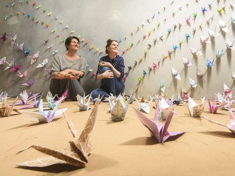 Plunge festival coordinator Lou Gumb with Maclean High School teacher/librarian Del Cameron at the Origami cranes exhibition so far created by Maclean High students at the pop-up gallery in Yamba.