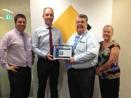 Accepting a Certificate of Appreciation from Lifeline Darling Downs CEO Derek Tuffield and Senior Manager Kate Greener are CBA Toowoomba Executives David Coote and Geoff Reid.