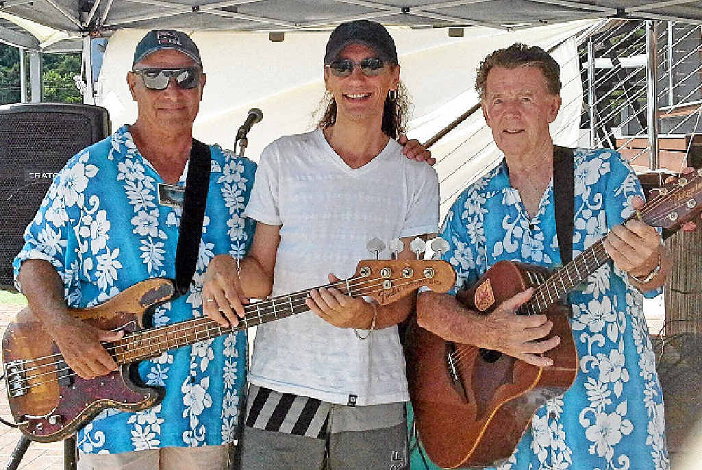 HELPING HAND: Cruise ship musician Sebastian Casis with local musos and cruise ship ambassadors Phil Campbell and Jim Hackett. Photo: Contributed
