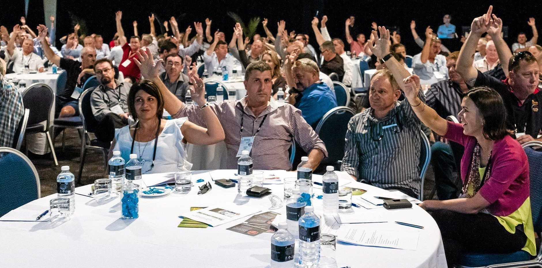 HAVE YOUR SAY: Delegates have their vote at a Trucking Australia conference.