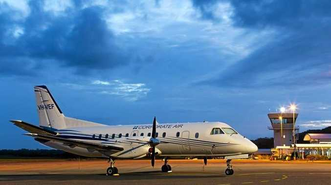 AIR LINK: Phil Scholes captures the arrival of Fly Corporate's 34-seat Saab aircraft offering daily flights to Brisbane.