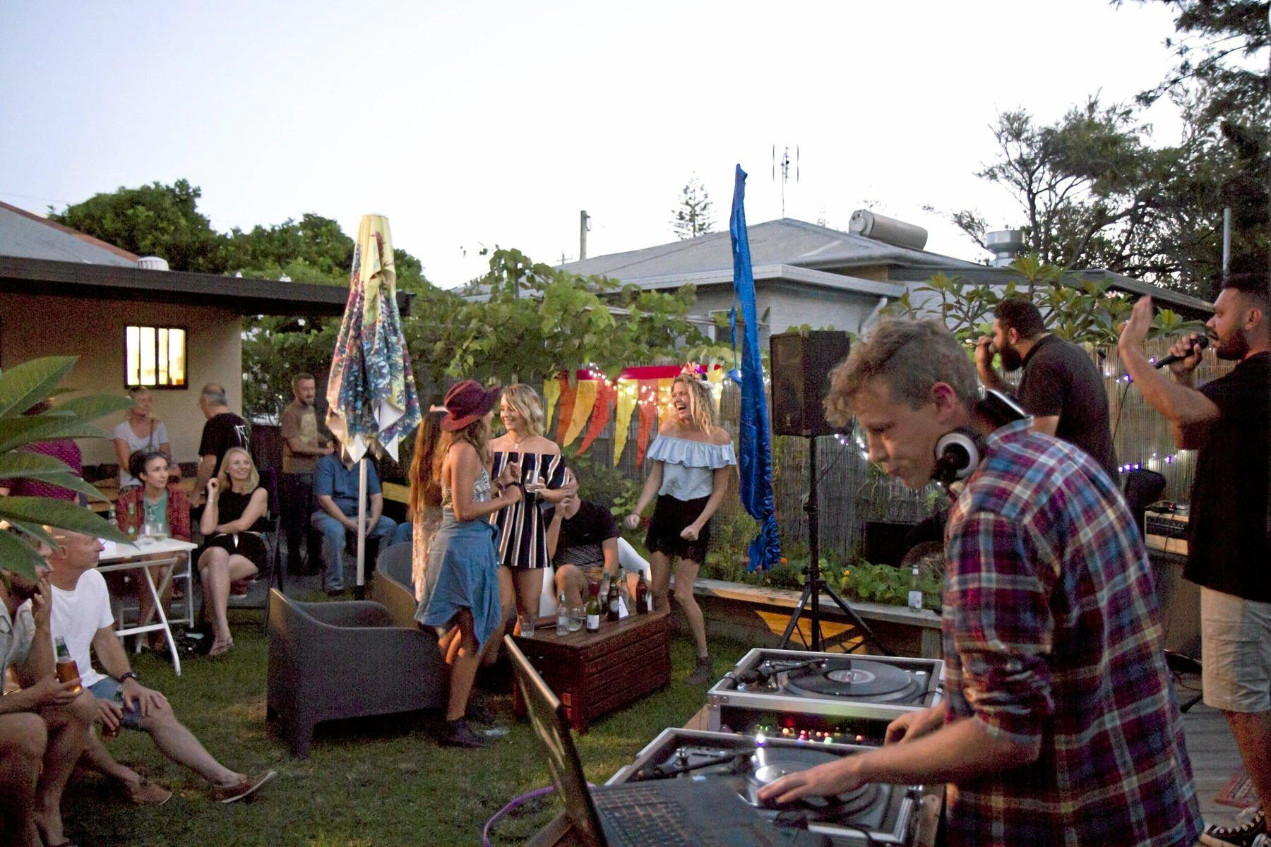 SPIN IT: Enjoying the tunes in the late afternoon at Leche. Photo: Dave Brandon