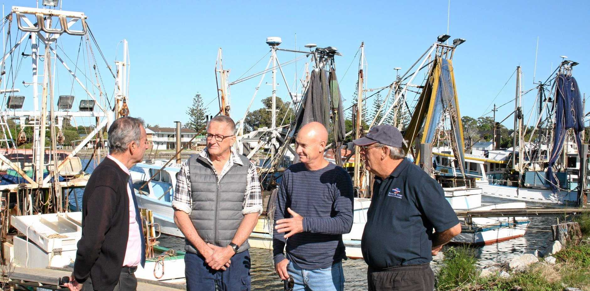 Member for Clarence Chris Gulaptis discusses the dredging works at Yamba boat harbour with longstanding members of the CRFC Donald Anderson and Graeme Williams and Chairman of the Clarence River Fishermen's Co-operative Board Don Mowbray.