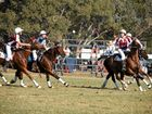 Warwick player Sophie Wells passes the ball to fellow Warwick player Bree Thornton for Queensland in nationals polocrosse action.
