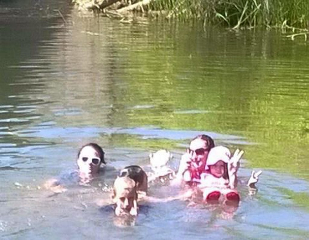 Photo from Lockyer Creek in Helidon with a mysterious 'ghost' child in background. Contributed