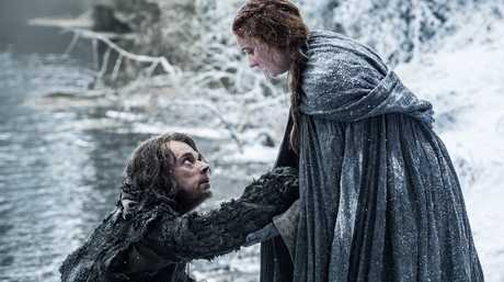 Alfie Allen and Sophie Turner in a scene from Game of Thrones.