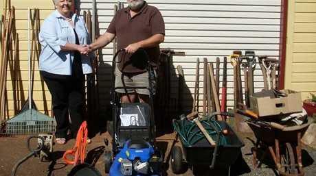 Mrs Jackie Doyle receives donated gardening goods from HOPE Inc. president Frank Ondrus.