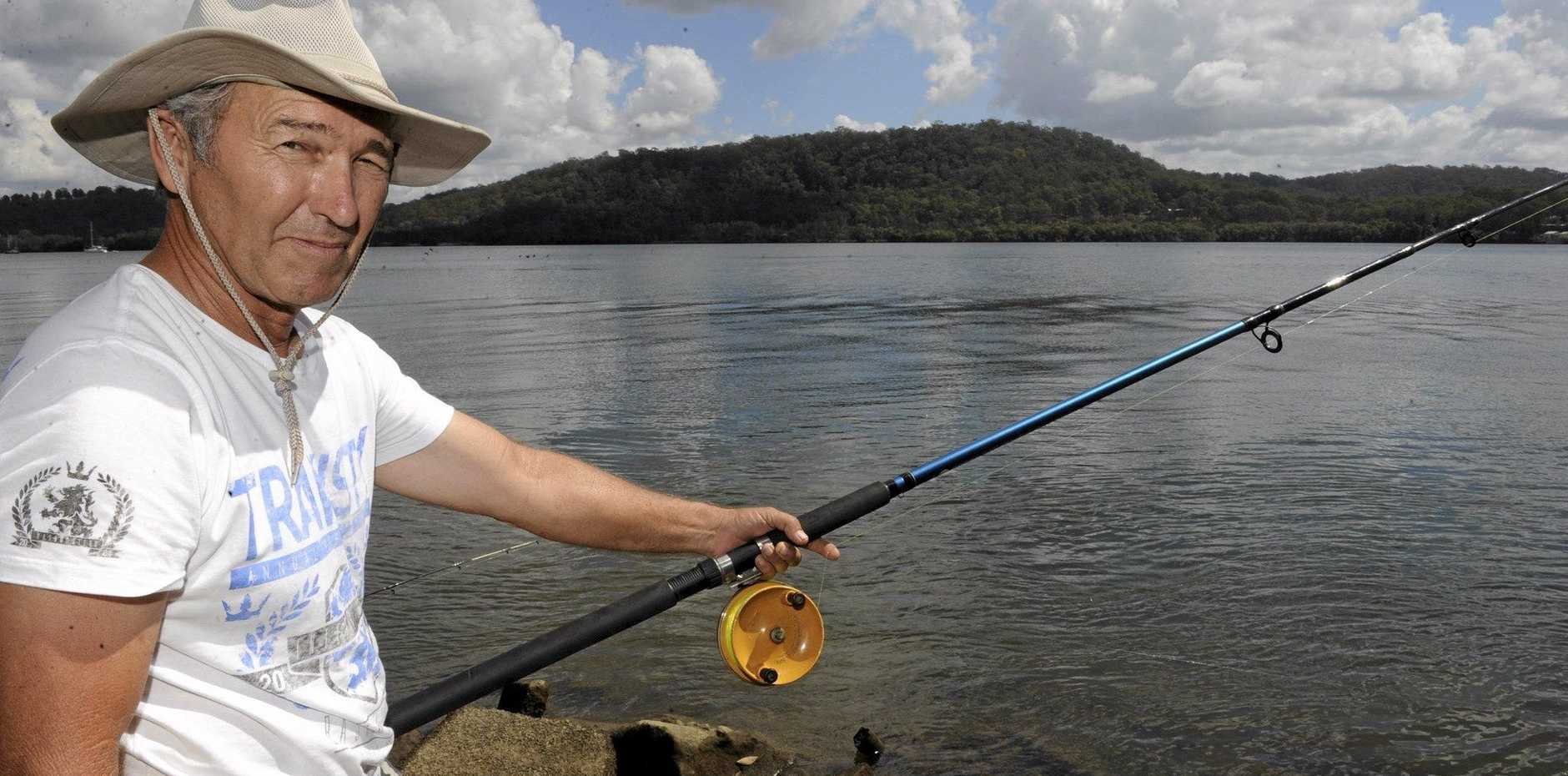 ESTUARY EXCITEMENT: Local angler Warren Howard waits for bite while fishing the Clarence River at Maclean recently.