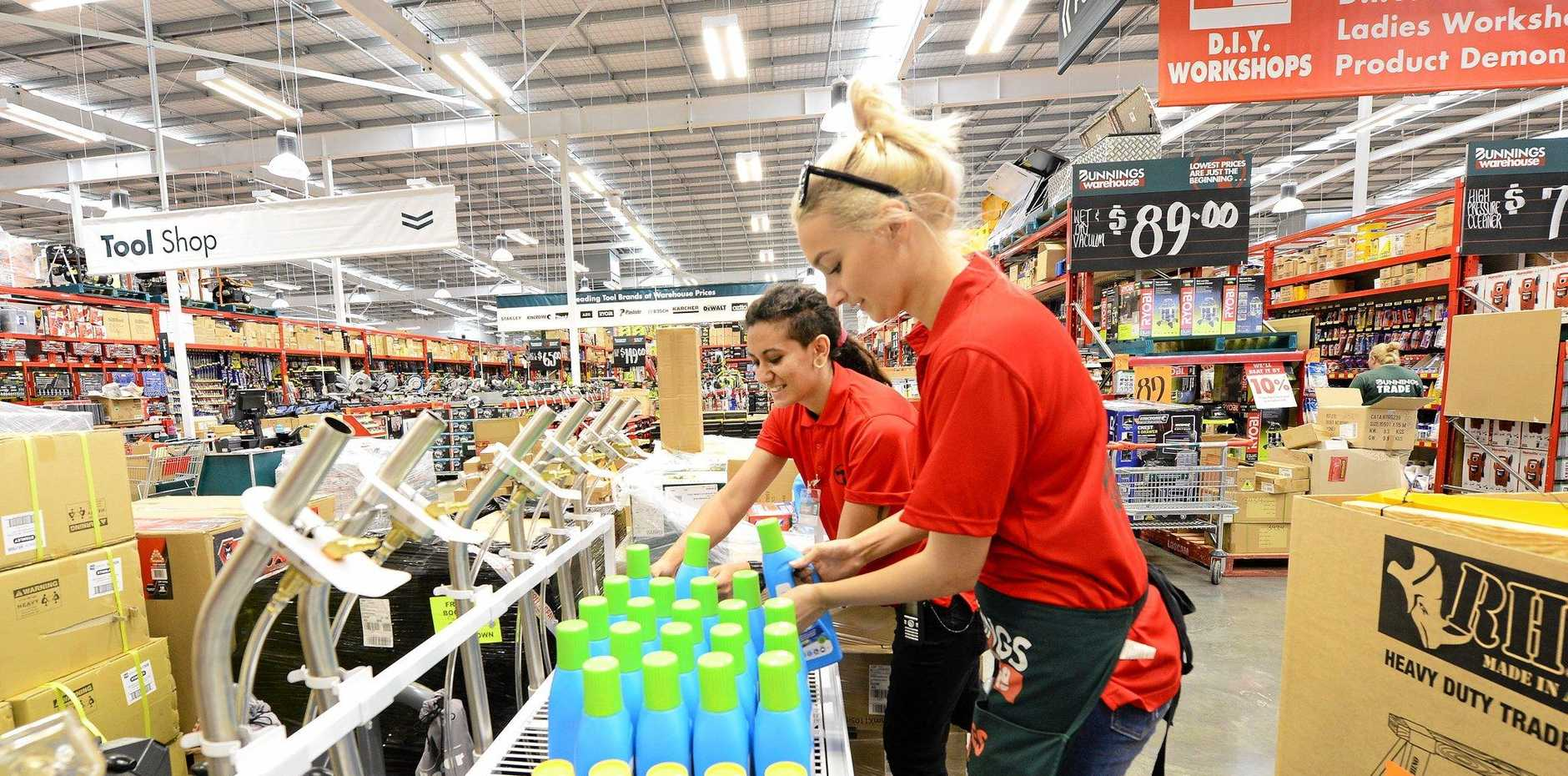 HUGE PROJECT: Bunnings Bundamba staff members Teesh Meyer (left) and Jordan Turner work hard to ready the store for its grand opening.