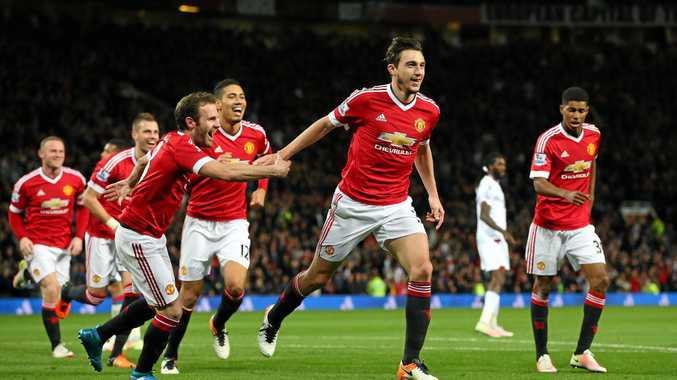 Matteo Darmian of Manchester United celebrates after scoring his side's second goal.