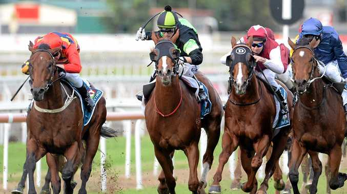 Jockey Timothy Bell (second from left) rides Sir Moments to victory at Eagle Farm Racecourse in Brisbane.