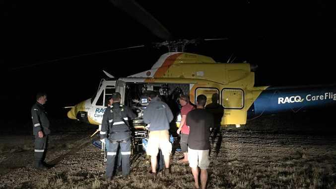 HARD LANDING: An injured skydiver is loaded onto the CareFlight helicopter for transport to Royal Brisbane Hospital.
