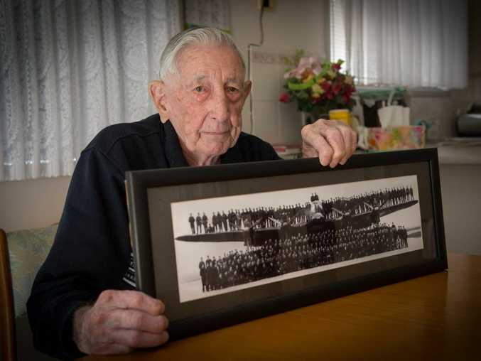 IN SERVICE: Coffs Harbour veteran Hilton Young, pictured with the Lancaster aircraft he served in during the Second World War.
