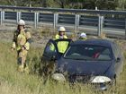 A car was rolled off the Warrego Highway and into a median strip after a collision with a truck about 2km east of Withcott.