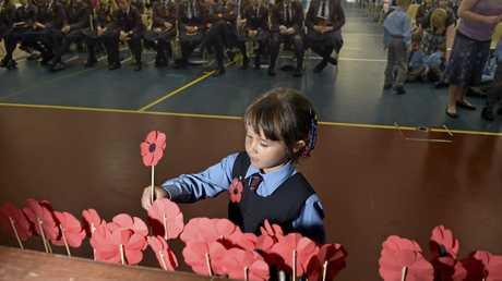Sophia Sanson-Male adds her poppy.