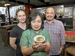 CUISINE: Emily Higgins (left) jois manager and owners Lindra and Josh Budiman at the soft opening of Skewers Indonesian restaurant.