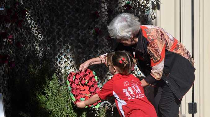 WE WILL REMEMBER: Caroline Summerville and her granddaughter Georgia at Beck Street Kindergarten in the self-built Remembrance Garden.