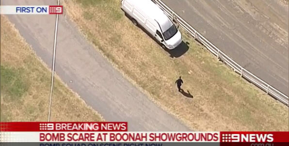 Police inspect a vehicle at Boonah Showgrounds after a report of a suspicious device.