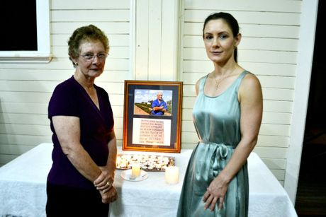 Helen Bender (right) with her mother Pam at a service to remember their father and husband George who took his own life after a long battle with the coal seam gas sector.
