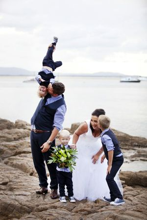 MUCKING AROUND: A candid moment caught on Amanda and Chris Krybolder's wedding day with Flynn, 7, Judd, 3, and Irish, 2. Contributed: Kirsten Cunningham Photography.