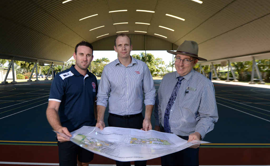 SPORTING FACILITIES: Sports director Justen Parle, capital development manager Lindsey Hull and principal Eamon Hannan with the master plan for Emmaus College's new Sports Centre which is set to begin construction in the coming months.