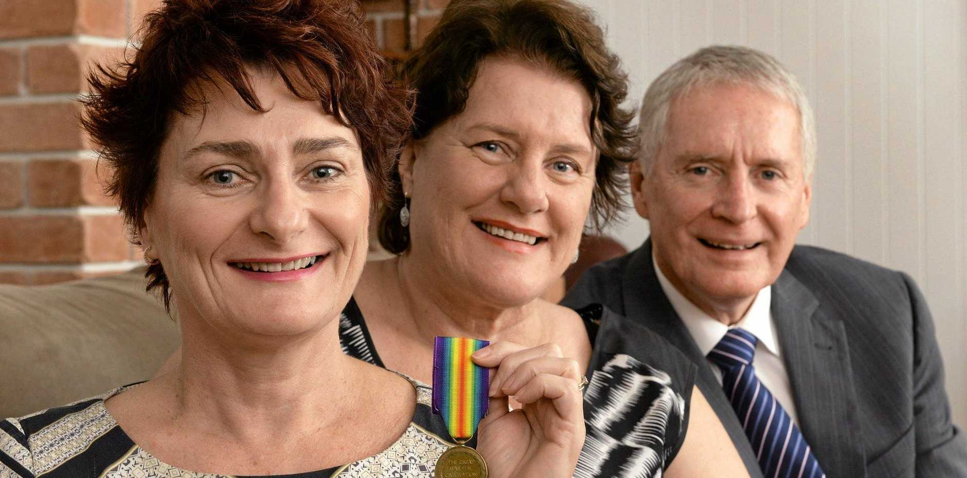 REUNITED: Siblings Cathy Dwyer, Anne Young and Neil Young with the recovered war medal of their father's uncle, Trooper James Quinn.