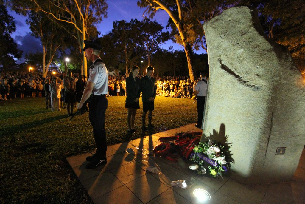 AT DAYBREAK: Members of the Whitsunday community gathering to pay their respects and lay wreaths at this morning's Anzac Day dawn service in Cannonvale. Photo Sharon Smallwood / Whitsunday Times