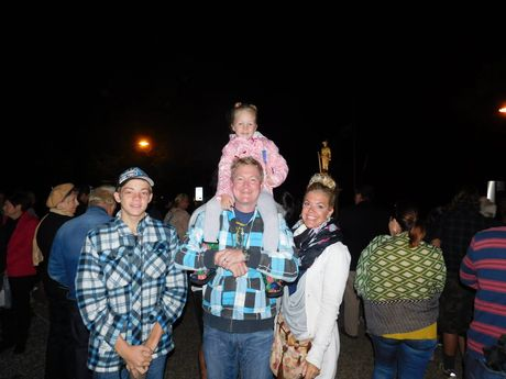 The Driver family, Kyall, 16, Idi Summer, 5, on dad Chris's shoulders, and SianAnzacB - Diggers march to parade at the Tewantin Anzac Day dawn service.