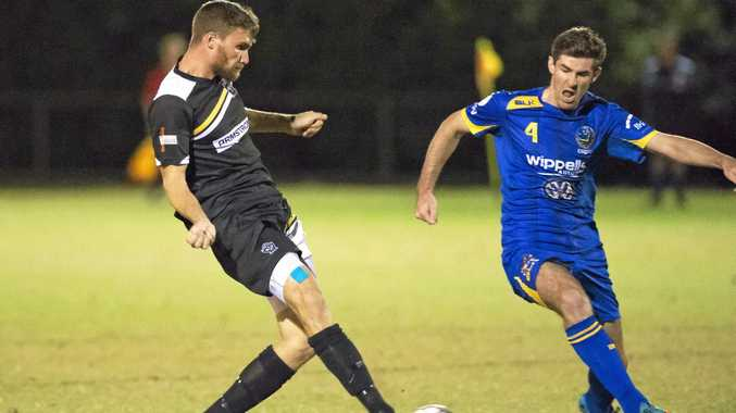 SWEET STRIKE: Frank La Spada scores one of his two goals for West Wanderers against USQ at Nell E Robinson Park.