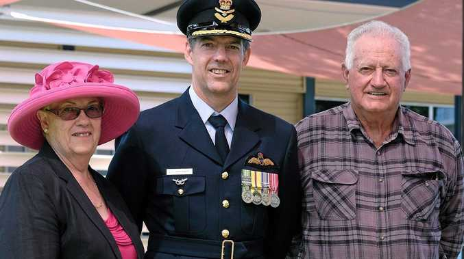 HOMECOMING: RAAF Group Captain Ross Bender (centre) with parents Val and John Bender.