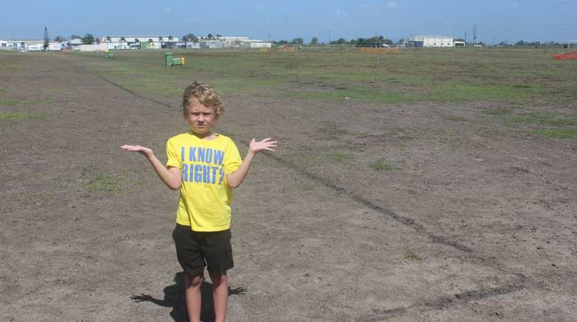 Junior football player Jhett Paterson on the field at the Mackay Football Park in Glenella.