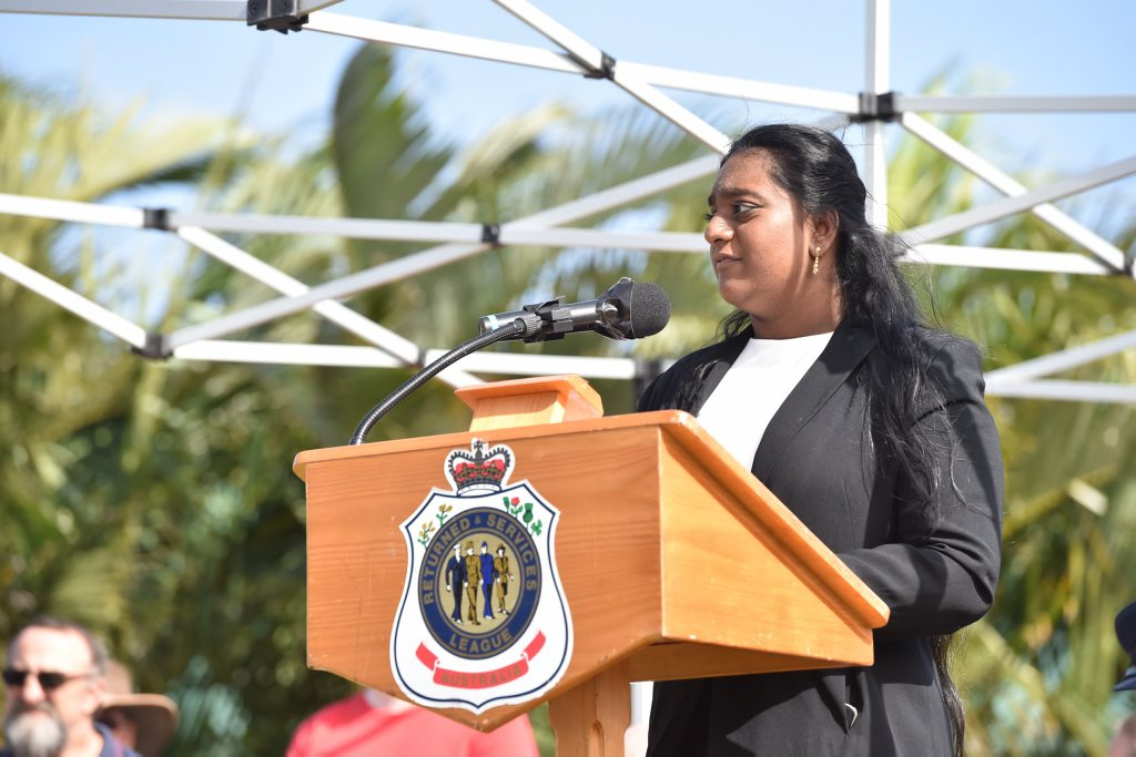 ANZAC VALUES: Kasthoory Jayankanth delivers her speech at the Hervey Bay main Anzac cceremony on Monday.