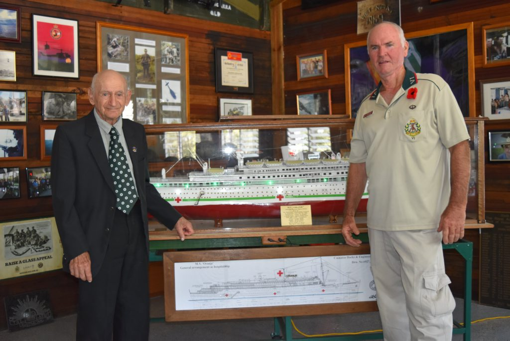 97-year-old Bundaberg man Jack Sulsters stands next to the replica hospital ship he made for the Toogoom RSL sub-branch. President Ken Higgins stands on the right. Photo Hannah Baker / Fraser Coast Chronicle