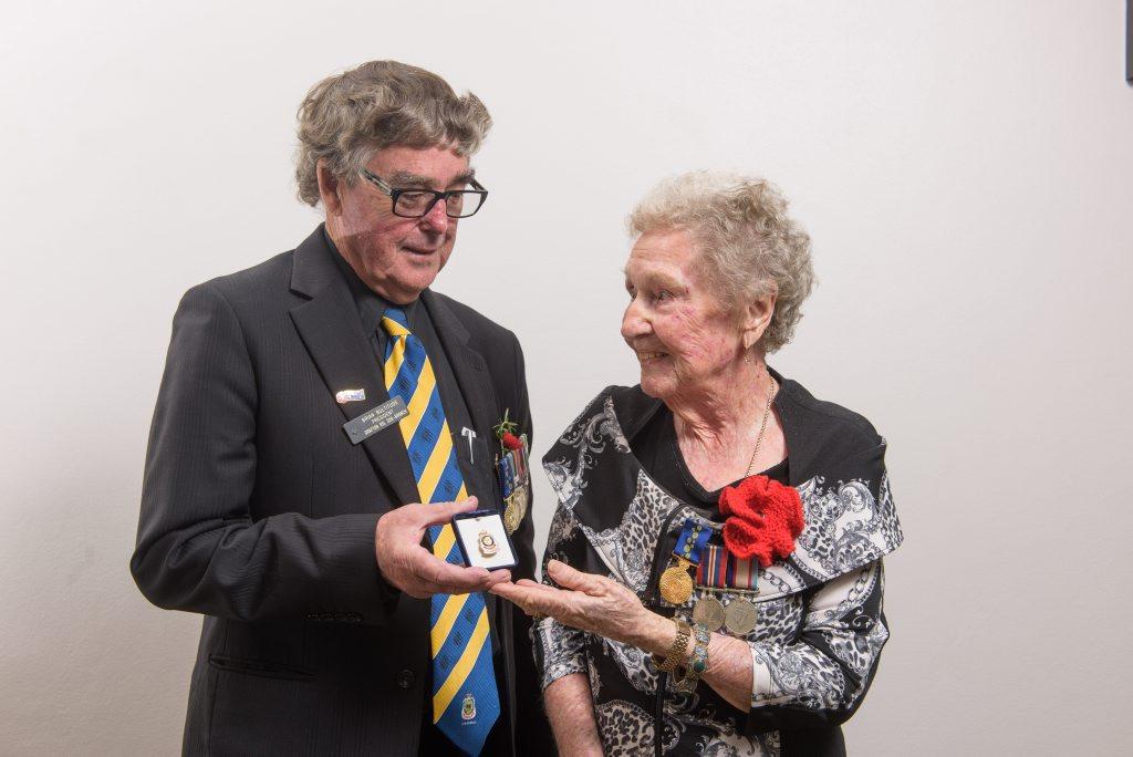 LIFE MEMBER: Grafton RSL Sub-Branch president Brian Bultitude presents Joan Muir with her life membership badge.