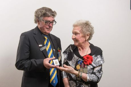 LIFE MEMBER: Grafton RSL Sub-Branch president Brian Bultitude presents Joan Muir with her life membership badge.