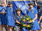South Grafton Public School students lead their schools march with a wreath at the South Grafton Anzac day service.