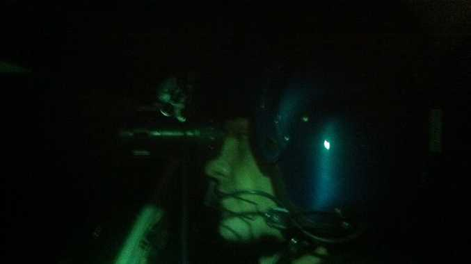 RESCUE: CareFlight Pilot Brent Hall uses night vision goggles to search for a vessel in distress.