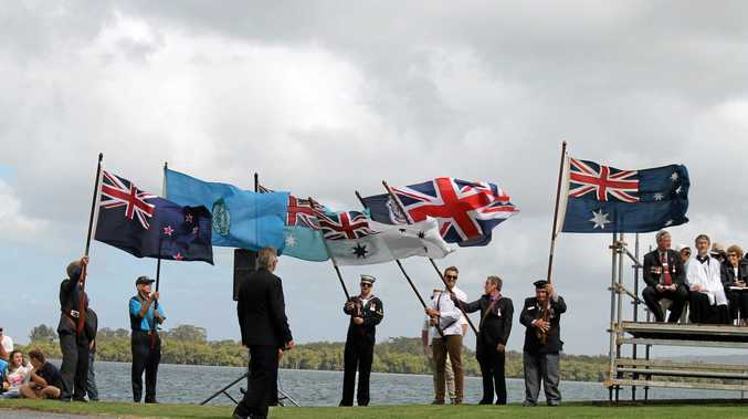 Flags fly at Ballina's Anzac Day service.