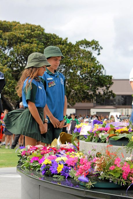 PAYING THEIR RESPECTS: School children lay wreaths during the Ballina RSL Sub Branch Commemoration of Anzac Day yesterday.