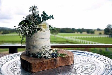 Paleo wedding cake by Jenny Zwemer, adorned by Lola's Wildflowers.