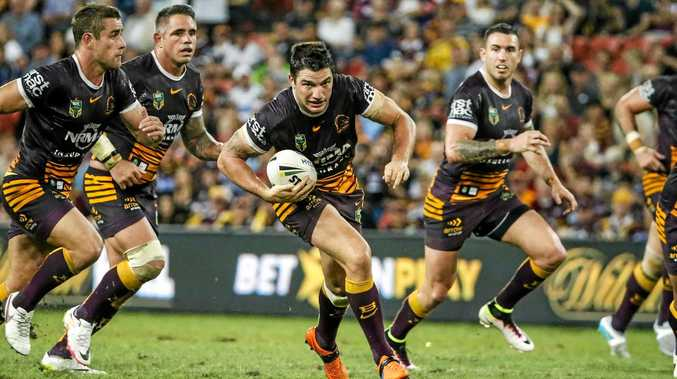 Matt Gillett in action with hooker Andrew McCullough and Brisbane, Queensland and now Australian teammates Corey Parker and Darius Boyd in support.