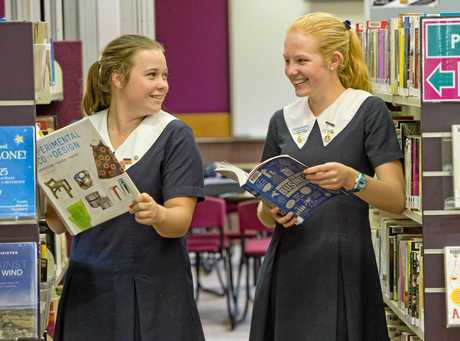 STICKING IT OUT: The Glennie School students Nicola Sainsbury (left) and Christine Mundell are determined to finish Year 12 so they work in their dream jobs.