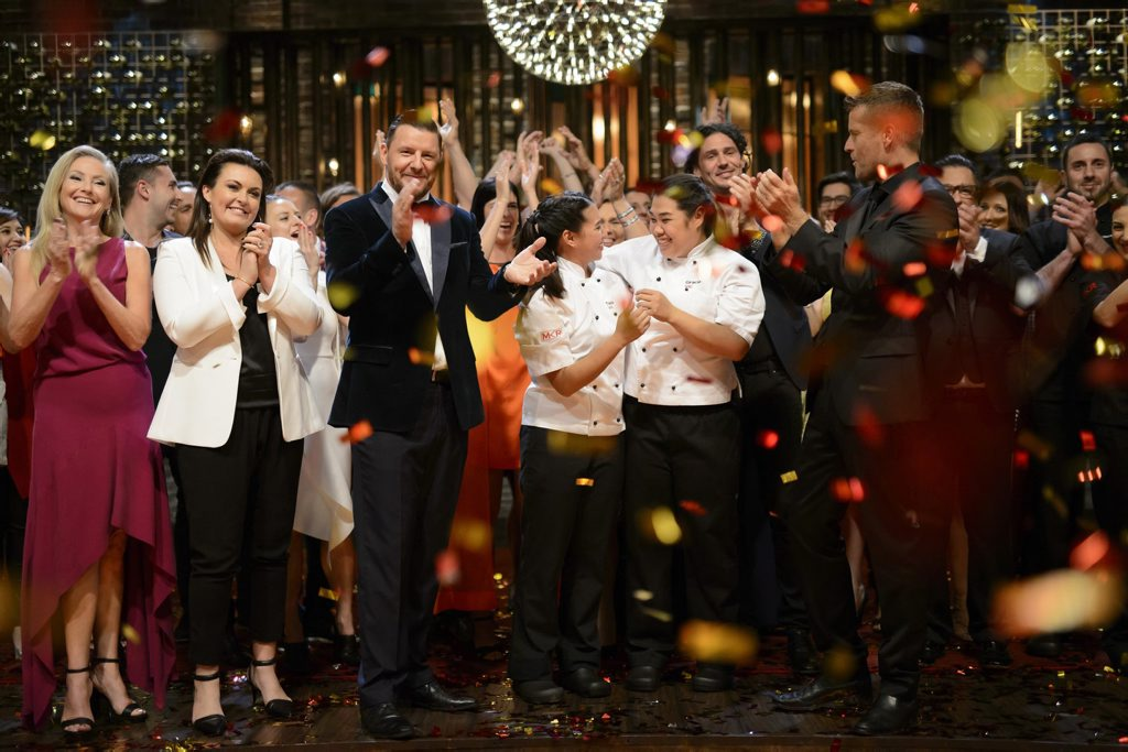 My Kitchen Rules winners Tasia and Gracia Seger pictured with judges, from left, Liz Egan, Karen Martini, Manu Feildel, Colin Fassnidge and Pete Evans.