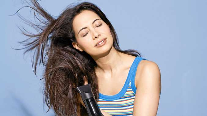 Master the art of blow drying your hair at home with a few simple moves.