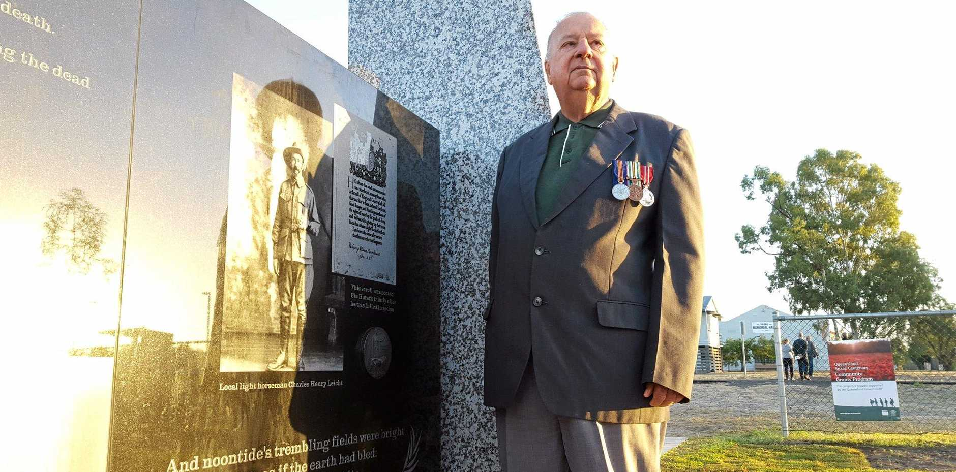 PRIDE: Bob Leicht stands next to a photo of his father, Charles Henry Leicht, at Yuleba's Anzac Day Dawn Service on Monday.