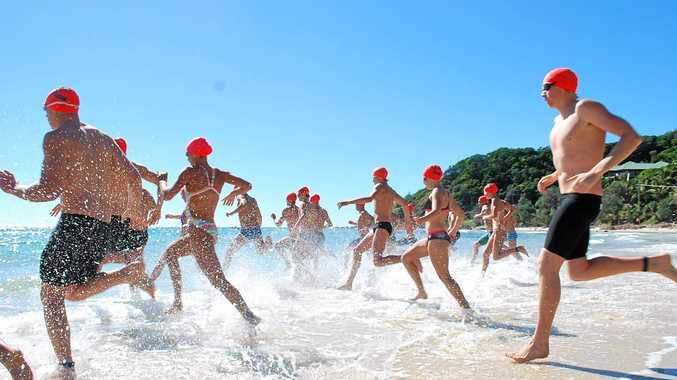 MAKING A SPLASH: Competitors hit the water at the start of the Byron Bay Ocean Swim at Wategos Beach. The event is now in its 29th year and will be held on Sunday.