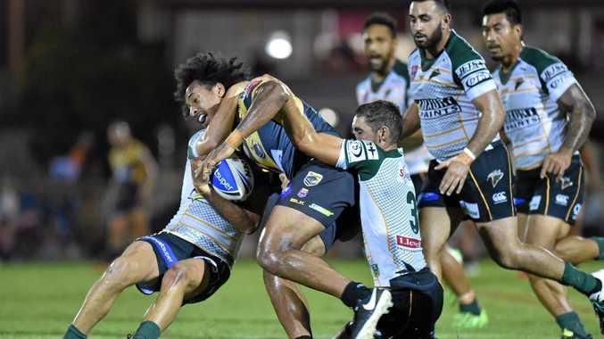 TOOWOOMBA TACKLE: Ipswich backs Haydan Lipp and Ben White tackle Sunshine Coast's Felise Kaufusi last weekend.