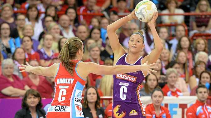 LOOKING BACK: Kim Ravaillion looks to pass in last season's grand final against her old team the Sydney Swifts.
