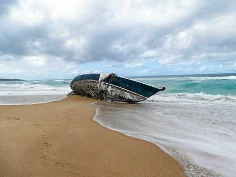 The rising tide again threatens the hull of a yacht washed up on Wooli Beach on Tuesday.Photo Tim Howard / Daily Examiner