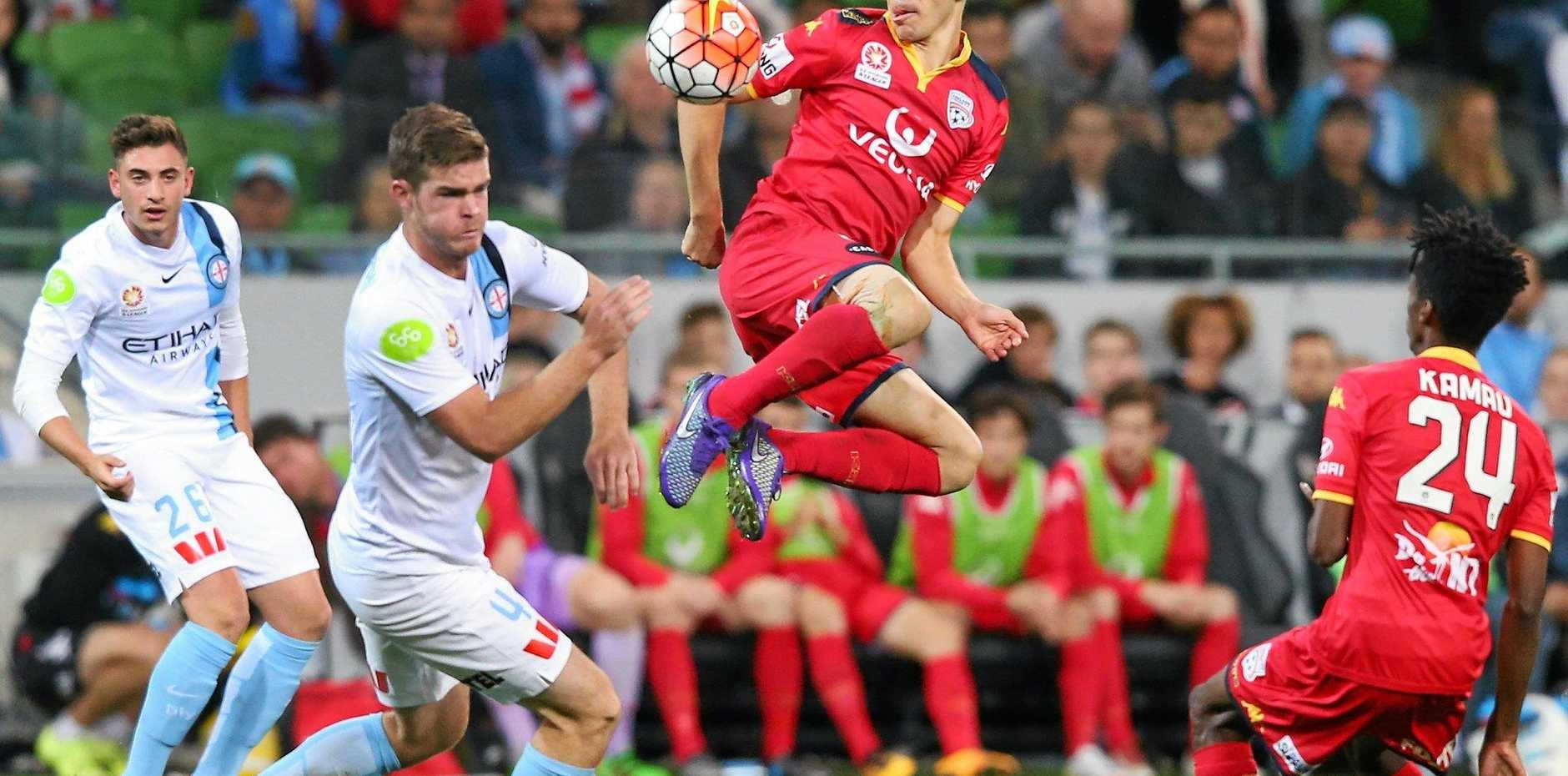 FLYING HIGH: Isaias gets above Melbourne City's Jacob Melling in the 2-0 win in round 27.